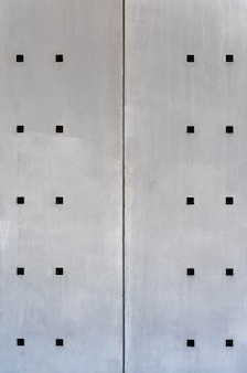 Abstract steel wall with square holes front view