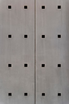 Abstract steel wall with square holes