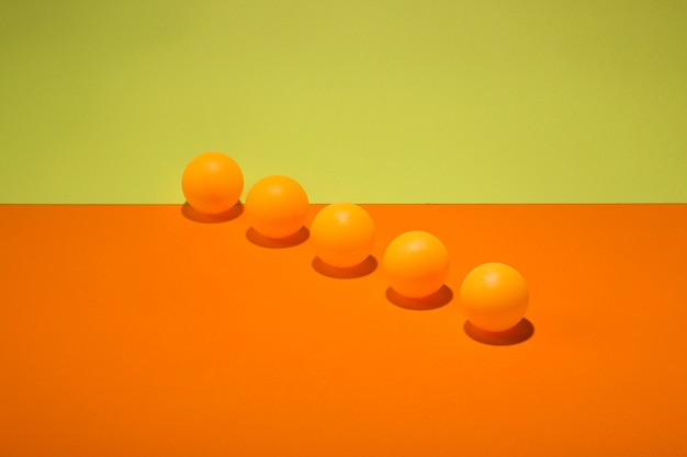 Abstract still life with orange balls on a colorful background