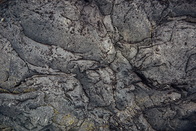 Abstract stone background. rough surface of gray rock with cracks and natural pattern