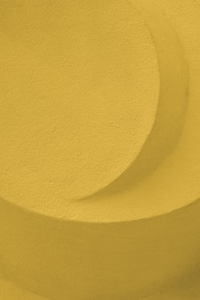 Abstract stone sculpture concrete yellow color. embossed concrete architectural detail