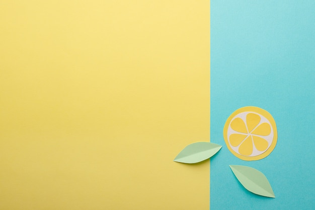 Abstract summer background - origami paper fruits on yellow-blue background