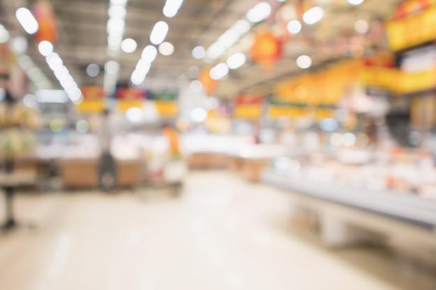 抽象的なスーパーマーケットの食料品店ボケ光でぼやけた焦点ぼけの背景