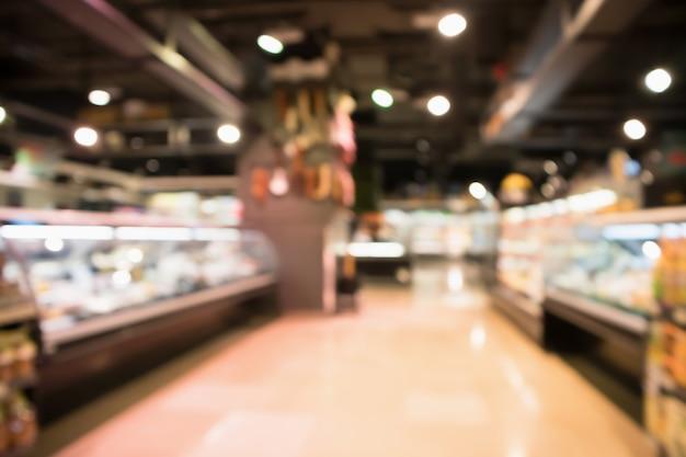 추상 슈퍼마켓 식료품점은 보케 빛으로 흐릿한 배경을 흐리게 합니다.