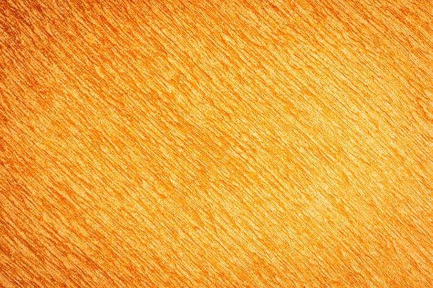 抽象的な表面とオレンジ色の綿織物テクスチャの織物