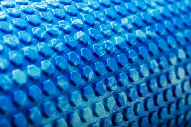 Abstract texture of a blue massage roller in the form of blue hexagonal cells. the entire screen as the background.