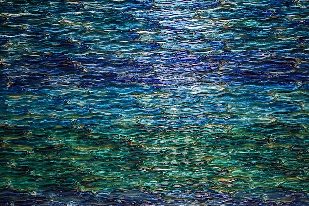 The abstract texture of the glass. the texture of the sea wave on the glass