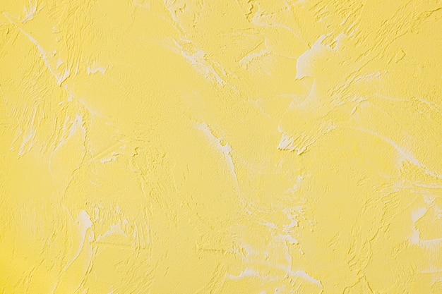 노란색 콘크리트 벽의 추상 질감