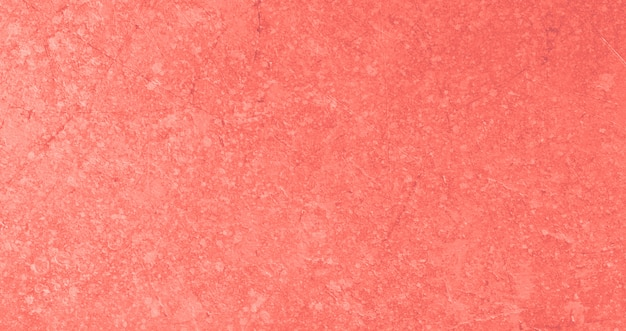 Abstract textured background in living coral color of the year 2019