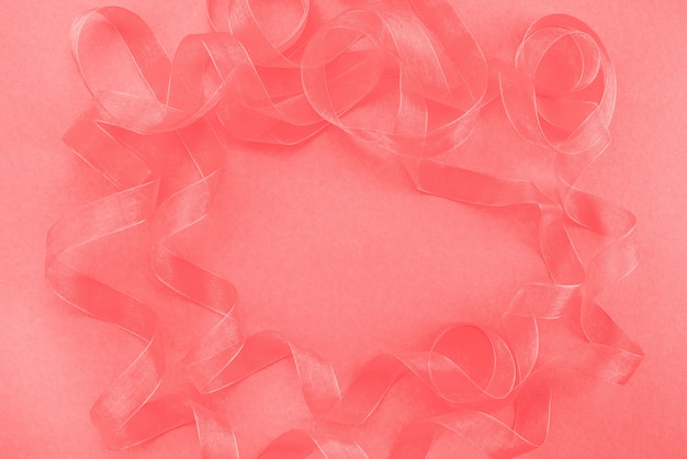 Abstract textured coral background ribbon curls top view Premium Photo