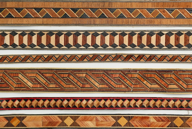 Abstract tribal pattern on wood background