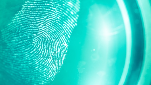 Abstract turquoise and green spots on a fingerprint, blurred background