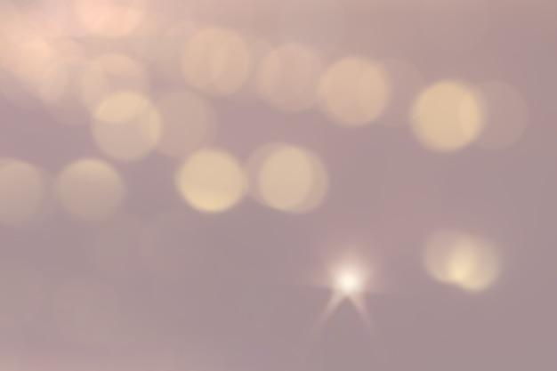 ボケの焦点がぼけたぼかしで抽象的なきらめく明るい背景。