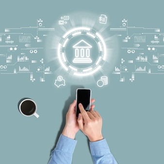 Abstract types of services in mobile banking are viewed by a person through a smartphone.