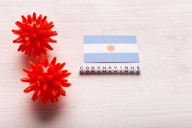 Abstract virus strain model of 2019-ncov middle east respiratory syndrome coronavirus or coronavirus covid-19 with text and flag argentina on white