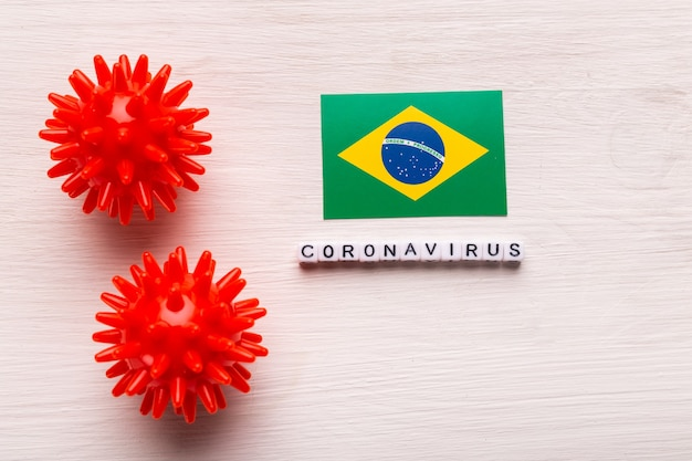 Abstract virus strain model of 2019-ncov middle east respiratory syndrome coronavirus or coronavirus covid-19 with text and flag brazil on white