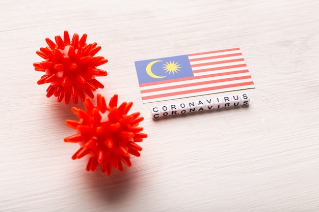 Abstract virus strain model of 2019-ncov middle east respiratory syndrome coronavirus or coronavirus covid-19 with text and flag malaysia on white