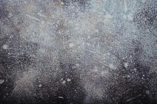 Абстрактная стена с пятнистой зернистой текстурой