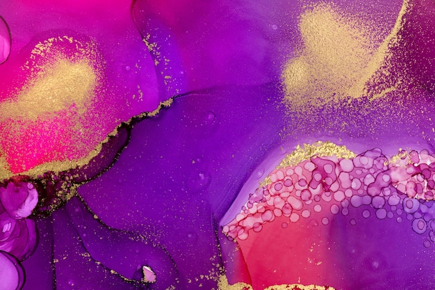 Abstract watercolor gradient background with gold glitter and droplet texture