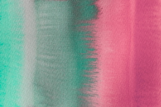 抽象的な水彩画の緑とピンクの背景
