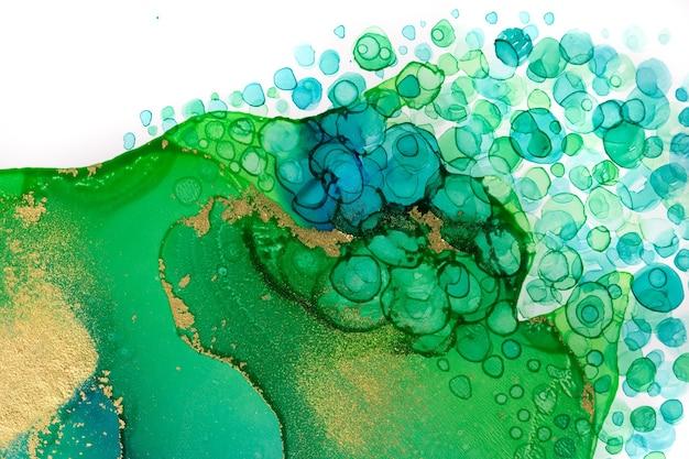 Абстрактная акварель чернила зеленая и синяя текстура с золотым блеском