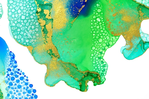 Abstract watercolor ink green and blue texture with gold glitter scattering