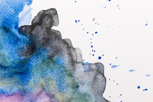 抽象的な水彩インクは、背景をはねます