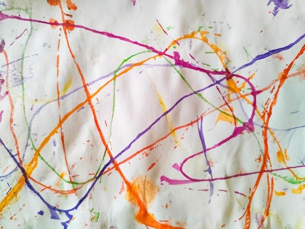抽象的な水彩線-紙の上のブラシストロークの背景。閉じる