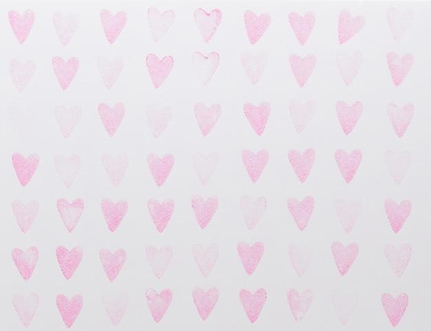 抽象的な水彩ピンクハートシームレスパターン