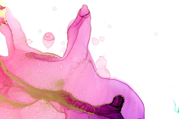 Abstract watercolor pink and violet gradient background with gold ink drops