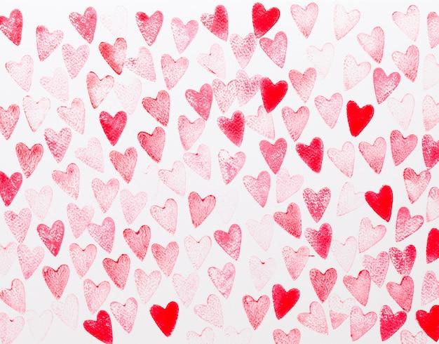 抽象的な水彩画の赤、ピンクのハートの背景。コンセプトの愛、バレンタインの日グリーティングカード。