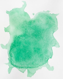 Abstract watercolour background with a green splatter of aquarelle paint