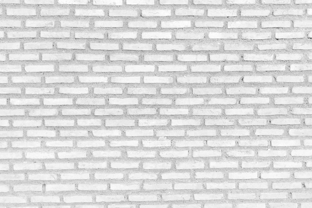 Abstract weathered texture white brick wall background