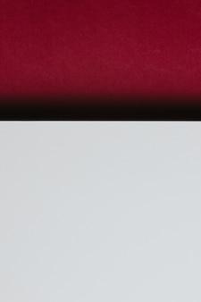 추상 흰색 및 적포도주 색 용지 형상 구성 배경, 최소한의 그림자, 복사 공간. 최소한의 기하학적 모양. 화려한 배경 개념