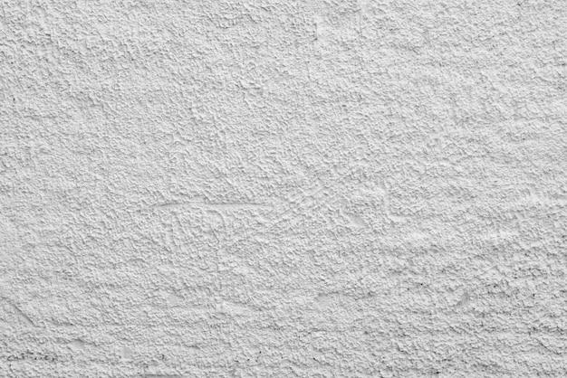抽象的な白い背景。石膏の粗い凹凸。壁面。