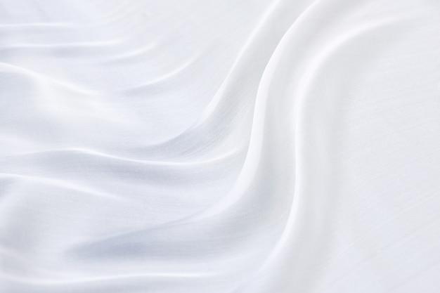 抽象的な白い寝具シーツまたは毛布の背景とテクスチャ