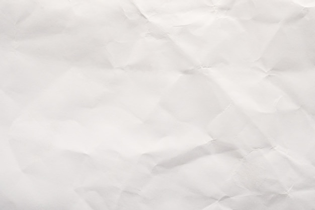 Abstract white crumpled paper texture background