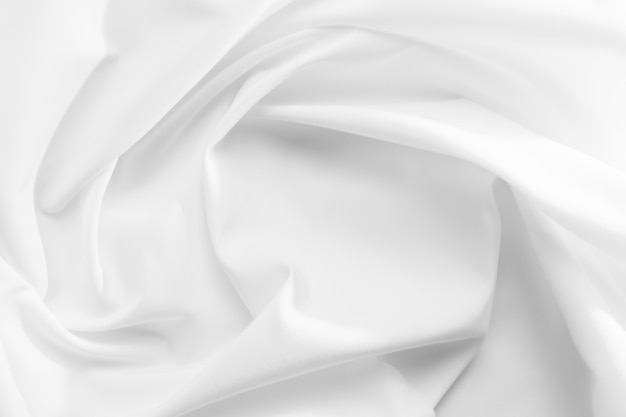 Abstract white fabric texture background. cloth soft wave. creases of satin, silk, and cotton.