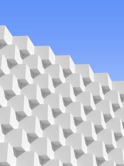 Абстрактная белая геометрическая архитектура, узор блоков, современный дизайн здания на фоне голубого неба. 3d-рендеринг.