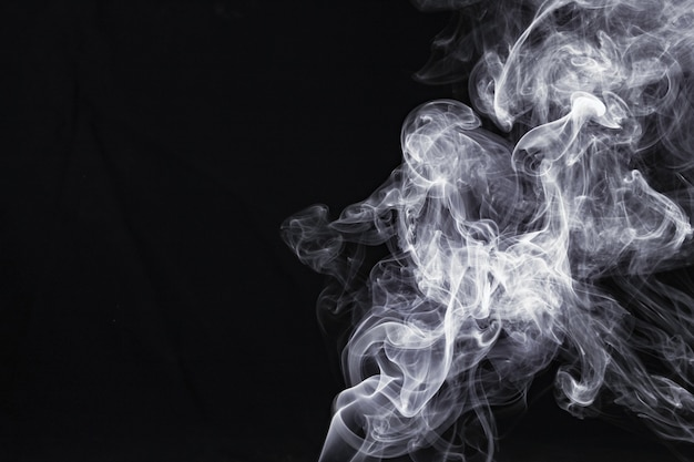 Abstract white smoke isolated on black background
