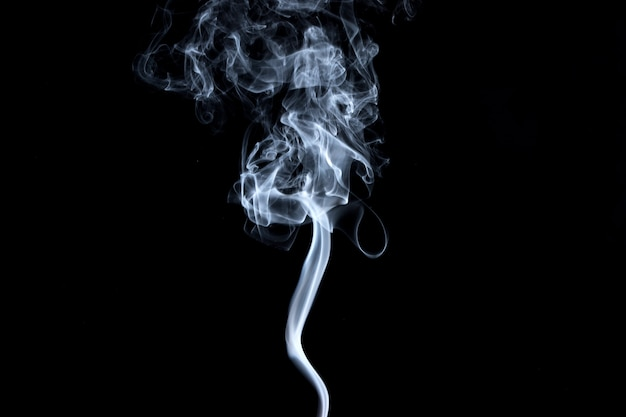 Abstract, white smoke isolated on black