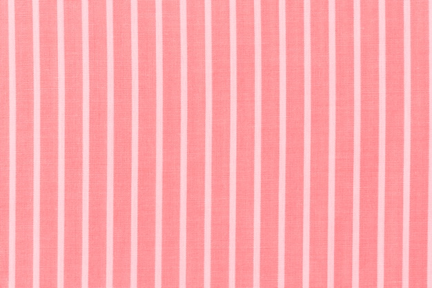 Abstract white stripes pattern on red textile background