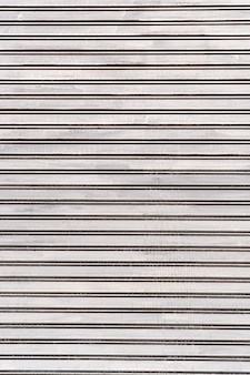 Abstract white stripes steel wall