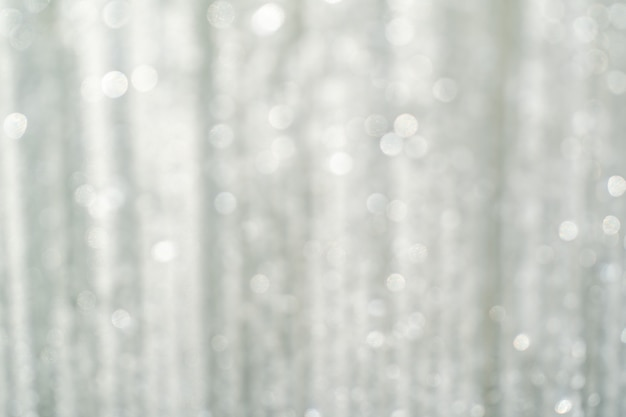 Abstract with blurred white light, white and silver