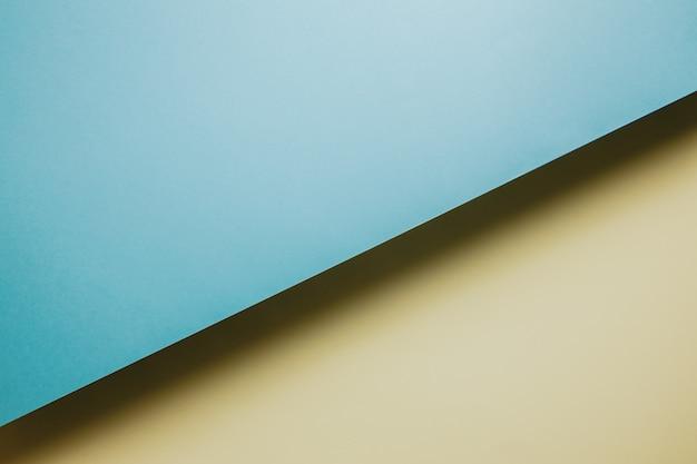 추상 노란색 및 파란색 용지 형상 구성 배경, 최소한의 그림자, 복사 공간. 최소한의 기하학적 모양. 화려한 배경 개념