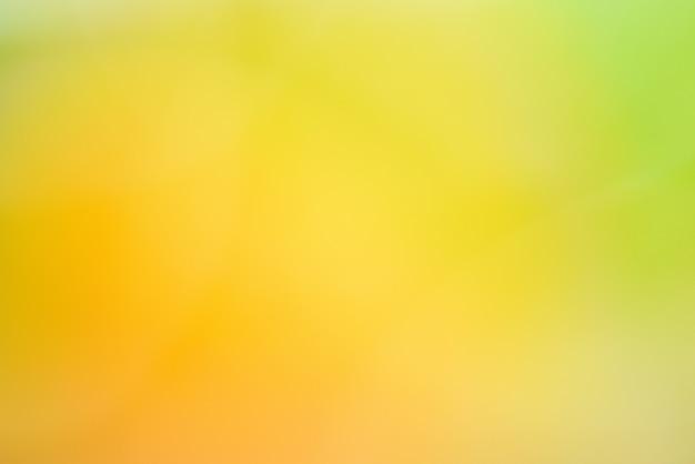 抽象的な黄色と緑の自然からテクスチャ背景をぼかし