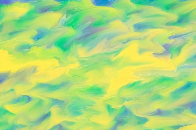 ブラシストロークで抽象的な黄色と緑の水彩画の背景。ぼやけた塗装テクスチャ、シュールな描画。流体塗料。紙に鮮やかなインク、カラフルなイラスト。波状のパターン。