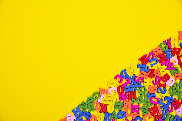 Abstract yellow background with multicolored letters
