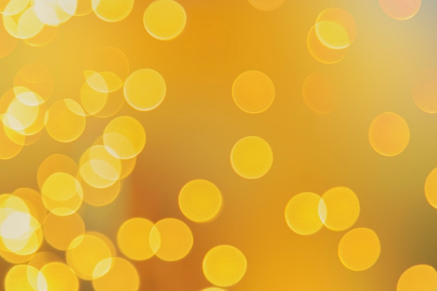 Abstract yellow blue light bokeh background with copyspace