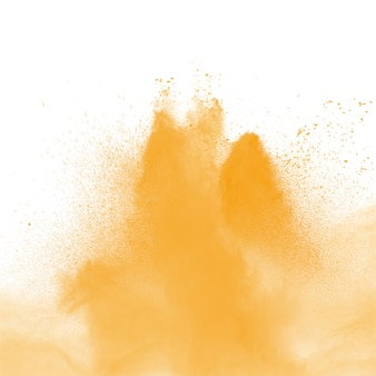 Abstract yellow dust explosion on white background. freeze motion of yellow powder splash.